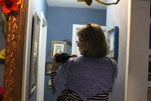 Me, attempting to model Edie's shawl/scarf, in my native appearance - with two sets of glasses on my head.